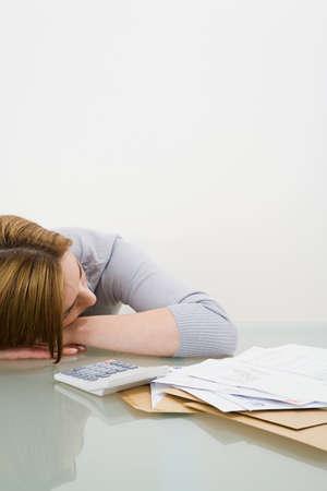 apathetic: Woman sleeping at desk LANG_EVOIMAGES