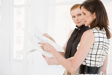 two persons only: Fashion designers looking at sketches