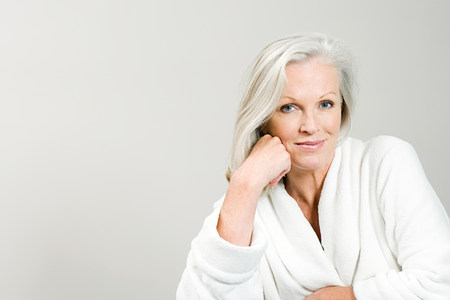 headshots: Portrait of middle aged woman wearing bathrobe