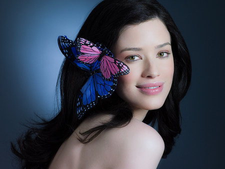 chic woman: Woman with butterflies in hair