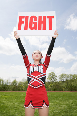 Cheerleader with fight sign LANG_EVOIMAGES