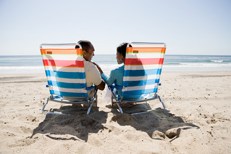 travel features: Couple relaxing on a beach