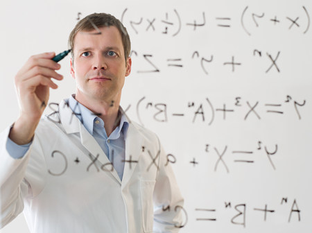 looking at viewer: Male scientist working out a formula