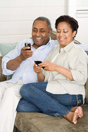 chic woman: Mature couple with cellphones