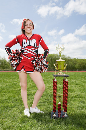 Cheerleader with trophy LANG_EVOIMAGES