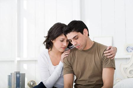 25 29 years: Sad looking hispanic couple