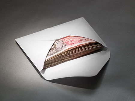 bribes: Fifty pound notes in an envelope