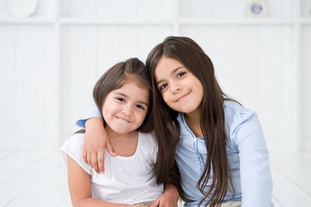 Portrait of hispanic sisters