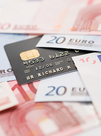 borrowing: Credit card and euro banknotes