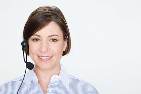 headshots: Woman wearing telephone headset LANG_EVOIMAGES