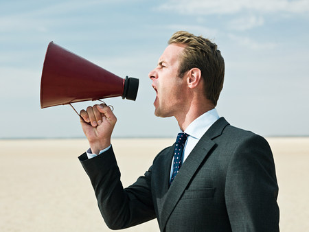parched: Businessman shouting in the desert