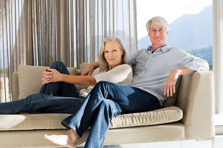 parlours: Middle aged couple reclining on couch