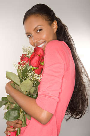 bunched: Woman holding a bunch of roses LANG_EVOIMAGES