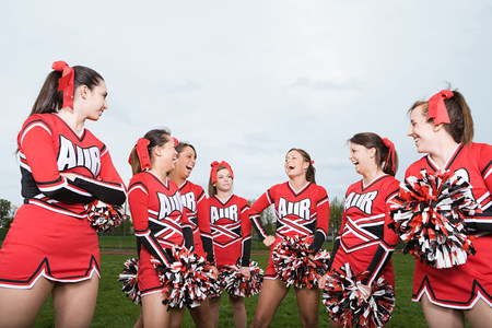 Cheerleaders laughing LANG_EVOIMAGES