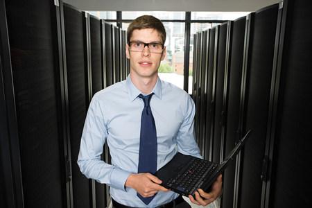 Male computer technician holding a laptop computer