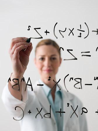 Scientist writing a formula LANG_EVOIMAGES