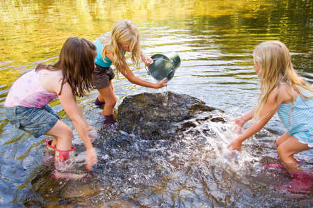 6 7 year old: Girls in river with bucket