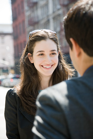 flirtation: Young woman smiling at a man LANG_EVOIMAGES
