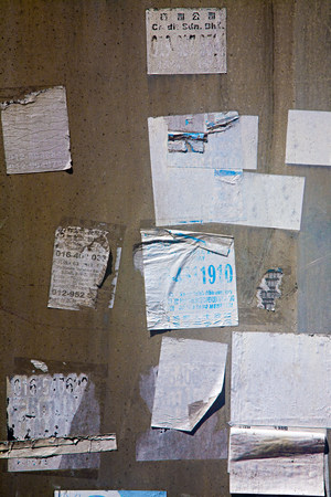 untidiness: Torn stickers on a wall LANG_EVOIMAGES