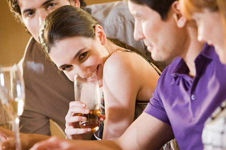 Four friends in a bar