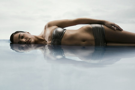 submerging: Young woman in water