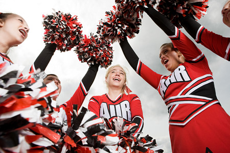 pom poms: Cheerleaders with pom poms LANG_EVOIMAGES