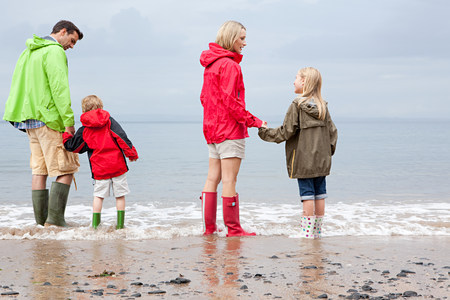 anorak: Family standing in the sea LANG_EVOIMAGES