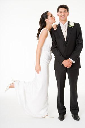 smooching: Bride kissing the groom