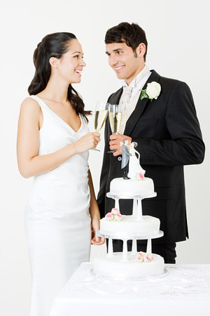 20 25 years old: Bride and groom toasting with champagne