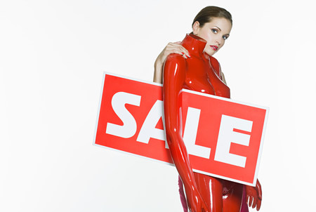 Woman with mannequin and sale sign