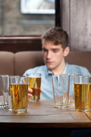 inebriated: Young man in bar LANG_EVOIMAGES