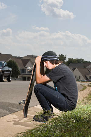 morose: Teenage boy with a skateboard