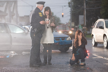 precarious: Police officer and young women at scene of accident
