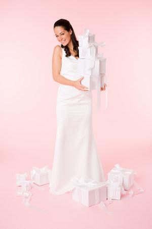 Bride holding a stack of wedding gifts LANG_EVOIMAGES