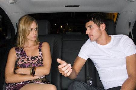 20 25 years old: Couple arguing in the back of a car