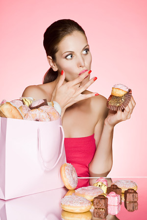 shopping binge: Young woman with a cupcake