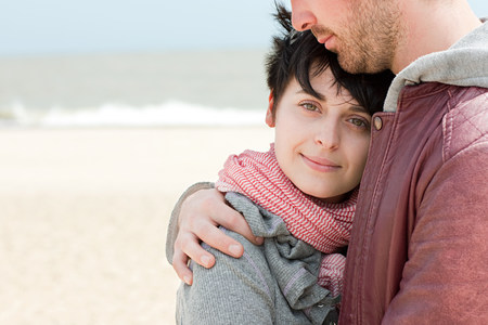 Young couple at the beach LANG_EVOIMAGES