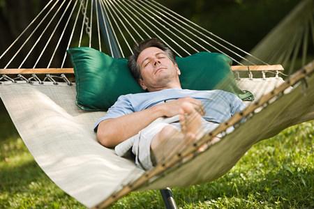 Man in a hammock LANG_EVOIMAGES