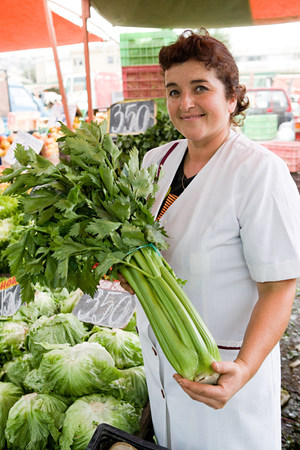 Market trader with celery