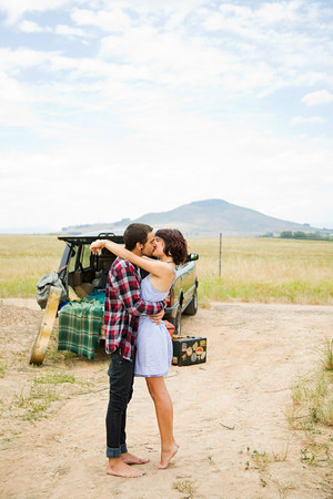 smooching: Young couple kissing outdoors