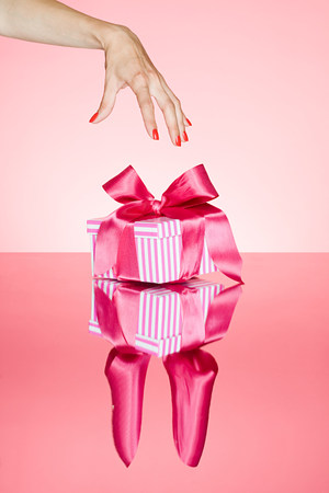 Female hand reaching for gift