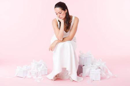 marrying: Sad bride looking at wedding gifts
