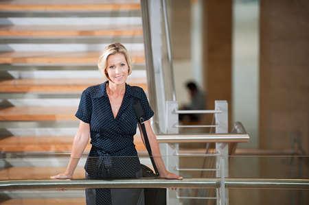 chic woman: Businesswoman on stairwell
