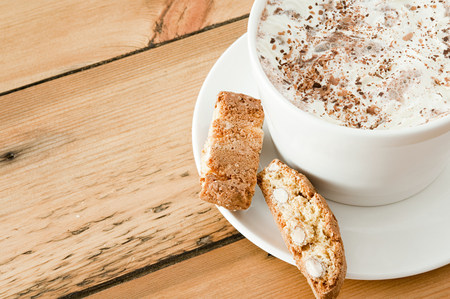 cropped shot: Cappuccino and biscotti