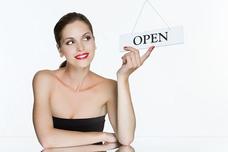 Young woman with open sign LANG_EVOIMAGES