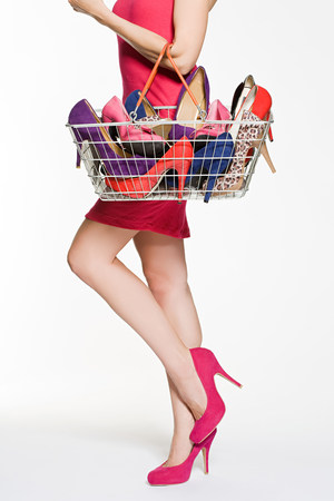 Woman with with shopping basket full of shoes LANG_EVOIMAGES