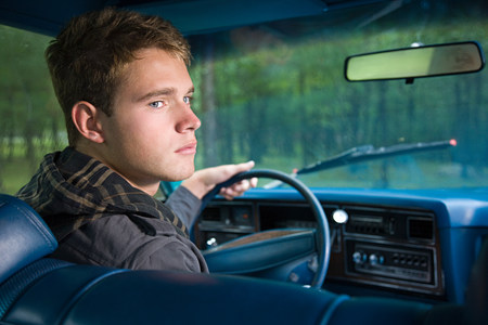 Teenage boy in car