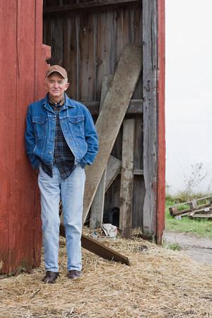 farmyards: Farmer outside barn