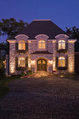 path to wealth: Large house illuminated