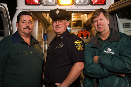 Policeman and emergency medical technicians
